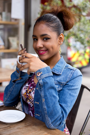 habbit: young woman enjoying a coffee