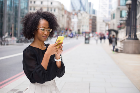 cellular telephone: young woman sending a text message