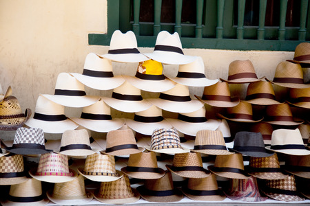 latina america: a pile of colombian sombreros at a street vendors stand