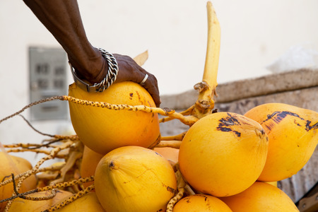 vendor: street vendor hand on his fresh produce Stock Photo