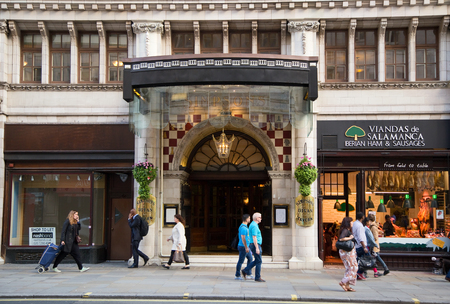 renowned: LONDON - SEPTEMBER 2ND: The exterior of Simpsoms on September the 2nd, 2015 in London, england, uk. The Simpsons Savoy savoy restaurant is renowned for its english cuisine.