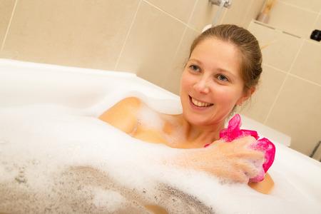 woman in bath: young woman enjoying a bath