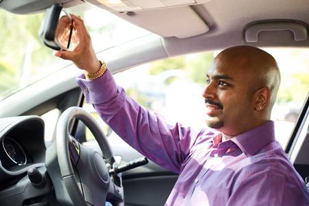 driver adjusting his mirror Stock Photo