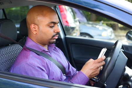 stopped: Man stopped at a carpark to check his phone messages