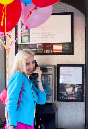 phonebox: party girl using a public phonebox
