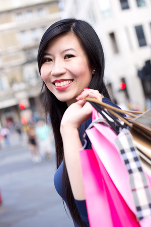 woman bag: Japanese girl holding shopping bags