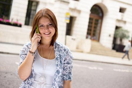 young womna talking on the phone in the street