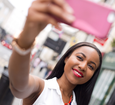 alone: young woman taking a selfie