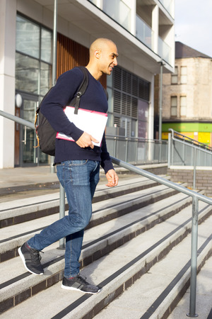 textbooks: young man with textbooks and a rucksack Stock Photo