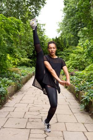 Jazz dancer performing a kick.