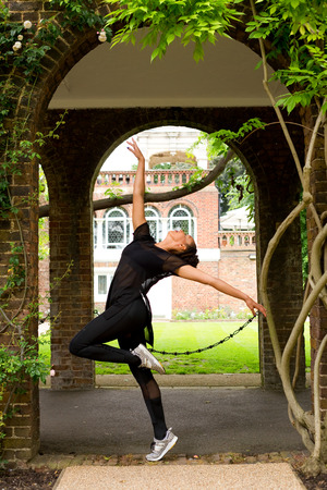performing: a jazz dancer performing under an arch