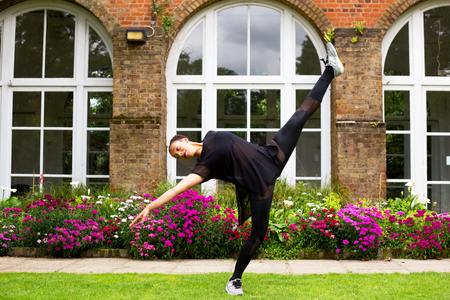 performing: A jazz dancer performing outdoors Stock Photo