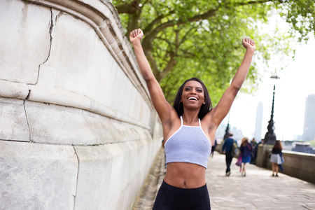 fitness goal: young woman celebrating a fitness goal