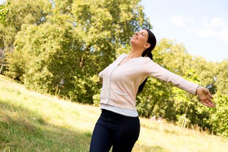 happy girl outdoors enjoying the fresh air Stock Photo