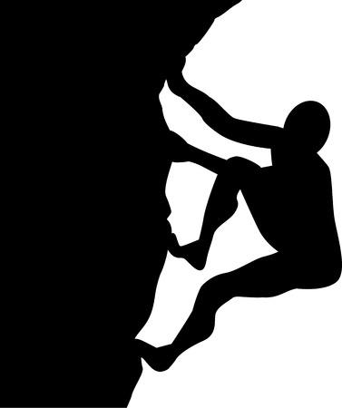 男が岩の上に登る