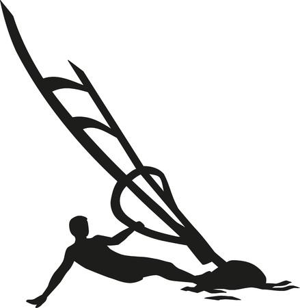 lying in: Windsurfing man lying in the wind
