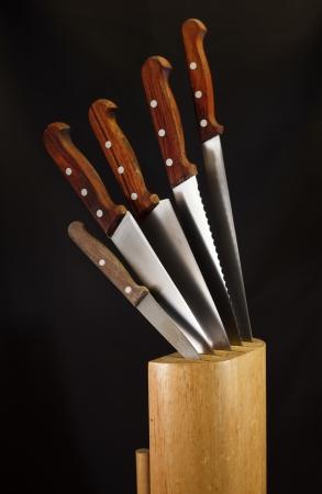 Kitchen knives on wooden block