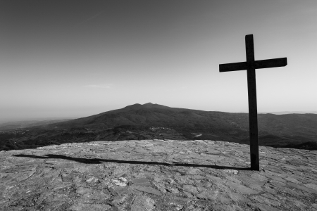Black cross and a mountain Stock Photo