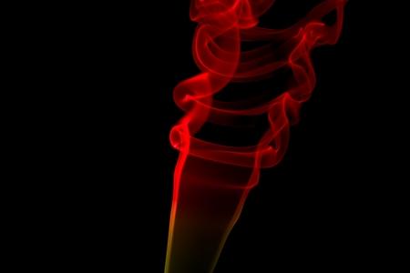 Red smoke swirls