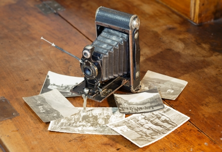 Old film camera and war pictures