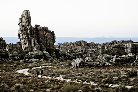 Two men hiking between the rocks