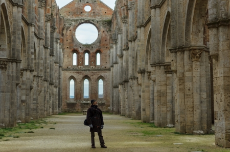 Visitor in San Galgano Abbey, Siena, Italy photo