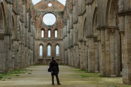Visitor in San Galgano Abbey, Siena, Italy