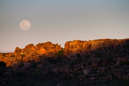 full moon and red rocks