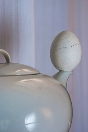 Teapot and egg abstract composition