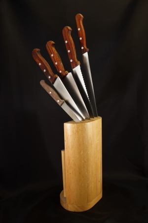 Kitchen knives set on black background Stock Photo