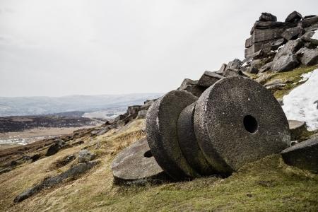 millstone: Old millstones at Stanage Edge, Peak District, UK