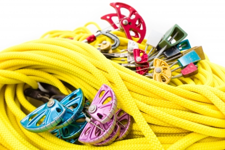 Close up shot of rock climbing gear on white background