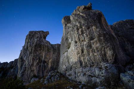 Night above limestone cliffs Stock Photo