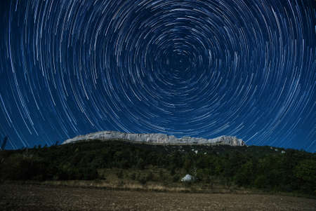 star trail: Star trail above Ceuse crag, France Stock Photo