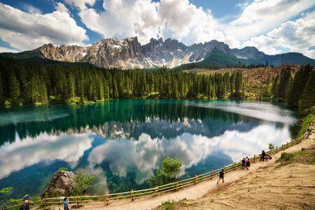 Reflections on Carezza Lake Фото со стока - 134879072