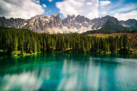 Carezza lake and Latemar mountains Фото со стока - 134879073