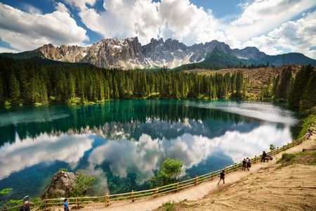Reflections on Carezza Lake Фото со стока - 134881885