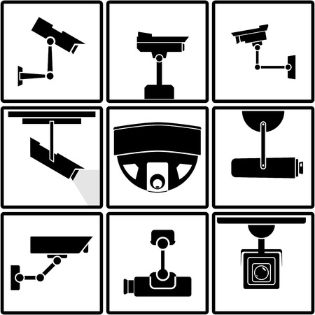 Nine black and white surveillance camera icons or stickers