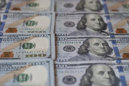New hundred dollar bills, rows of aligned banknotes closeup Фото со стока