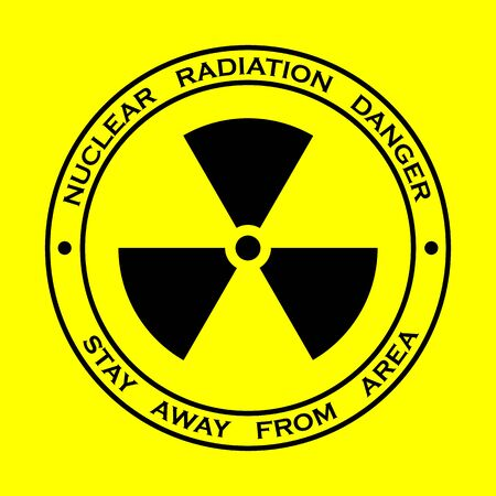 Black sign for nuclear radiation on yellow