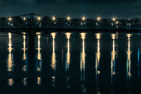alexandra: Alexandra Bridge between Ottawa, Ontario and Gatineau, Quebec reflecting over the Ottawa River at night.
