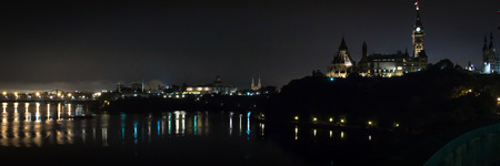 alexandra: A panoramic view of Ottawa (Canada) at night including the Alexandra Bridge and parliament buildings.
