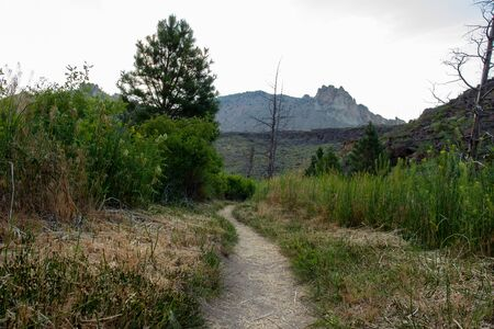 Hiking trail through Smith Rock National Park just ater sunrise. Explore the unknown and take an adventure.