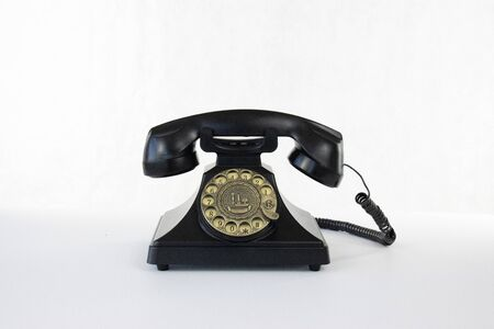 Rotary telephone on white isolated background.