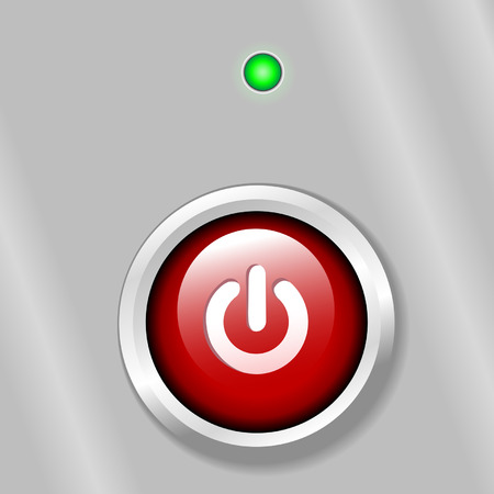 A bright red power on button on a metal background, with a gree LED light.