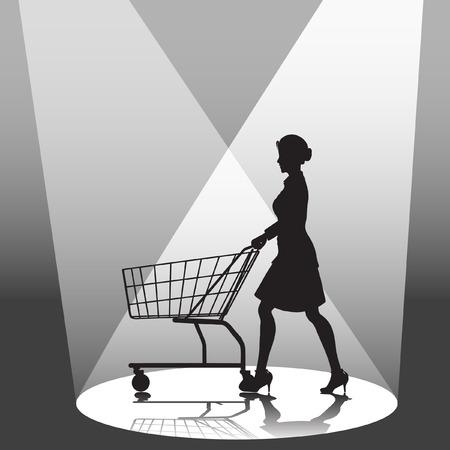 A woman shopper pushes a shopping cart in a spotlight.