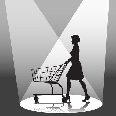 A woman shopper pushes a shopping cart in a spotlight.