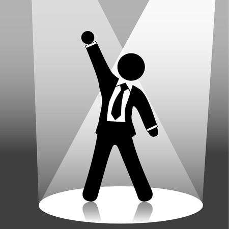 A  man symbol raises his fist in celebration of success on stage in a spotlight. Vector