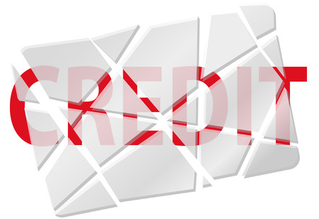 A credit card broken or cut to pieces to symbolize bad debt and other credit problems.