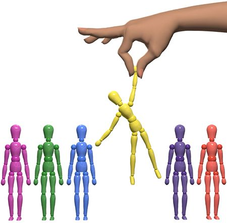 color choice: A female hand to find and choose a mannequin from a line of shiny artist dummies. Stock Photo